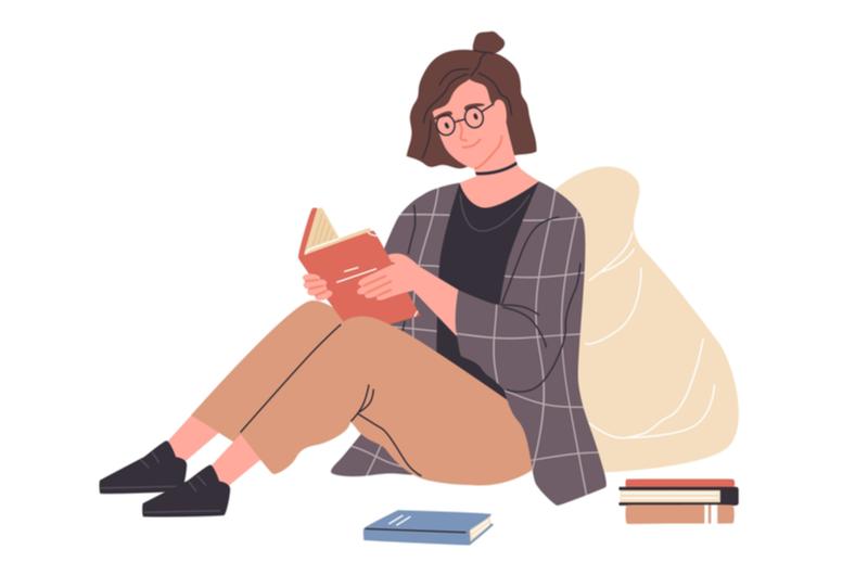 Webデザインの勉強に書籍を使う人のイメージ