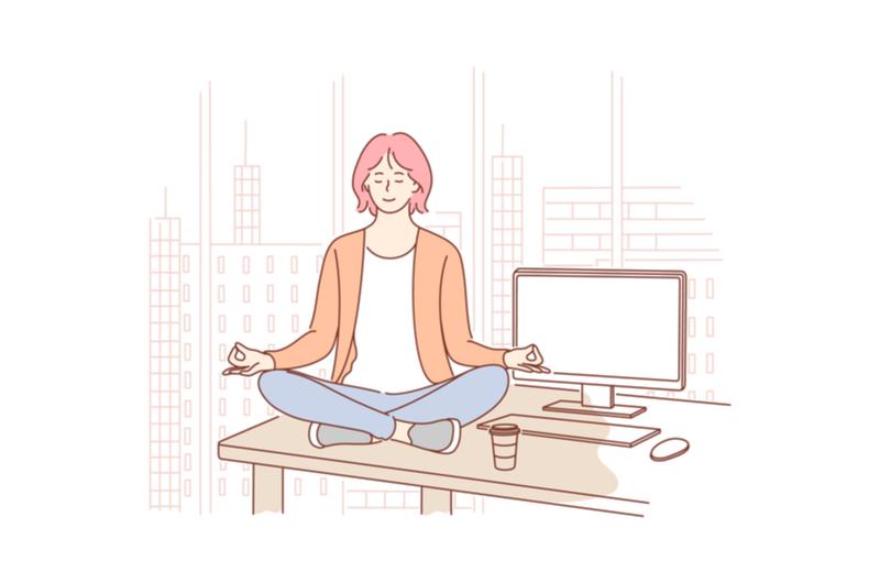オフィスで瞑想をする人