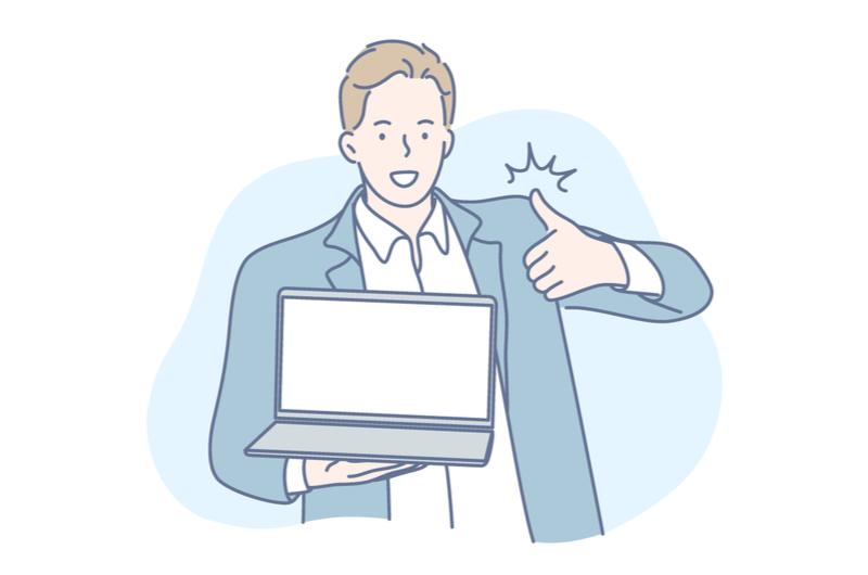 パソコンを持ってサインをする男性